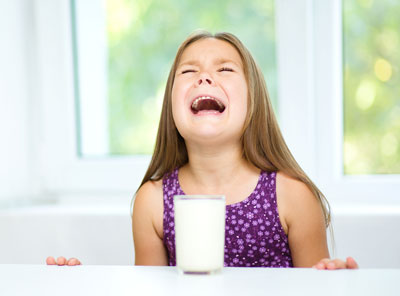 Girl crying over spilled milk